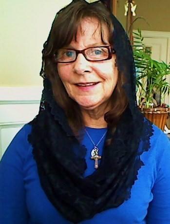 Dawn Marie Bernadette in the black Floral Infinity Veil